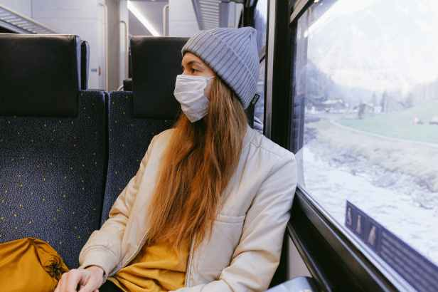 woman in gray knit cap and beige coat